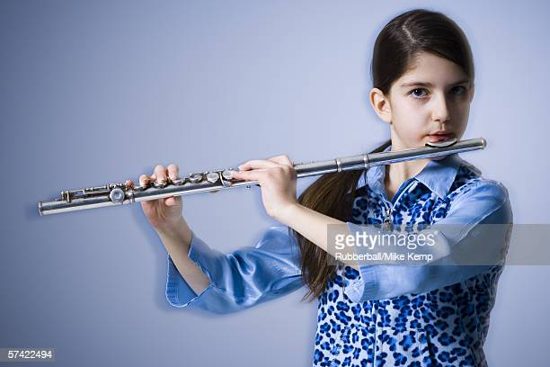 Portrait of a teenage girl playing the flute