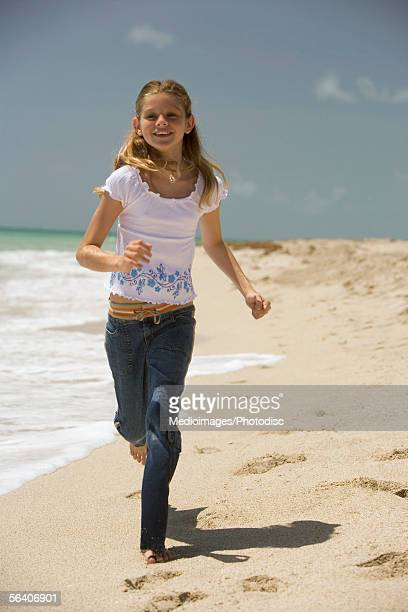 teenage girl running track ストックフォトと画像 getty images