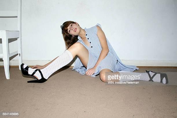 Portrait of a teenage girl sitting on the floor, Santiago, Santiago Metropolitan Region, Chile