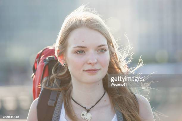 Portrait of a teenage girl, travellng with backpack