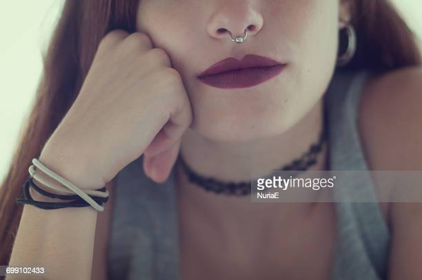portrait of a teenage girl with a nose piercing - nose piercing stock pictures, royalty-free photos & images