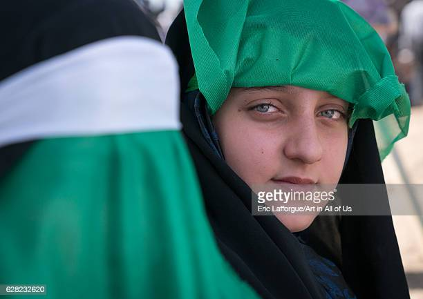 Portrait of a teenage girl with clear eyes during a traditional religious theatre called tazieh about Imam Hussein death in Kerbala Lorestan Province...