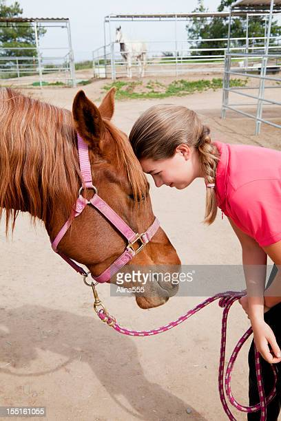 Portrait of a teenage girl with her horse