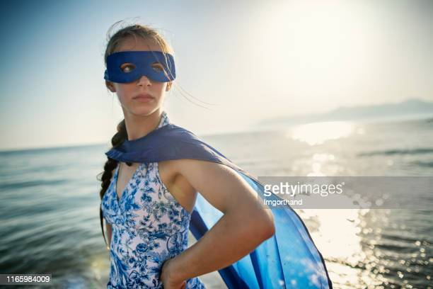 portrait of a teenage superhero girl - superhero stock pictures, royalty-free photos & images