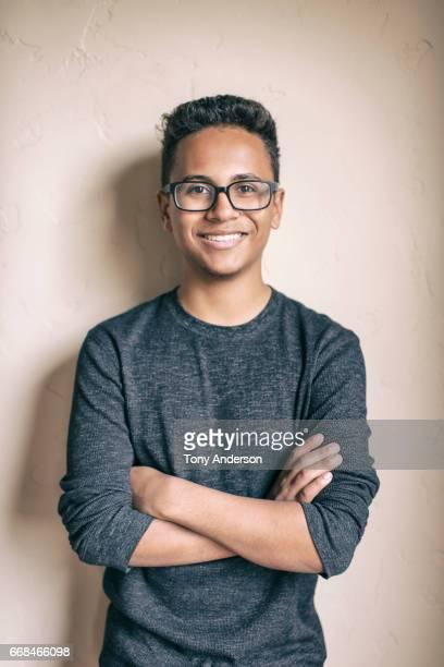 portrait of a teenaged boy with glasses - endast tonårspojkar bildbanksfoton och bilder