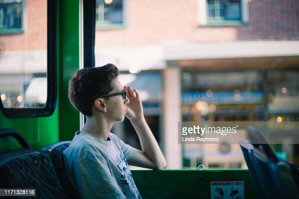 portrait of a teenager on a bus in the city of boston - massachusetts stock pictures, royalty-free photos & images