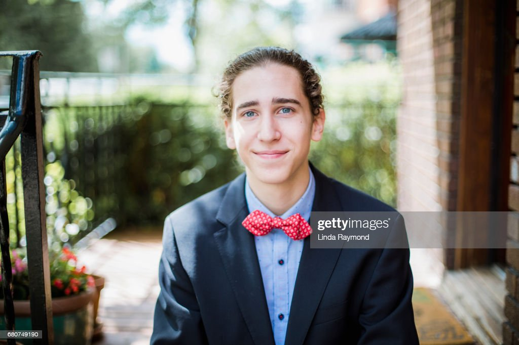Portrait Of A Teenager Smiling And Wearing A Suit For His Prom Night ...