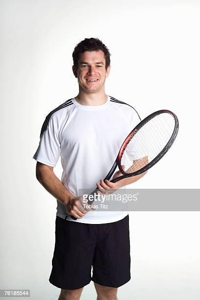 portrait of a tennis player - テニスラケット ストックフォトと画像