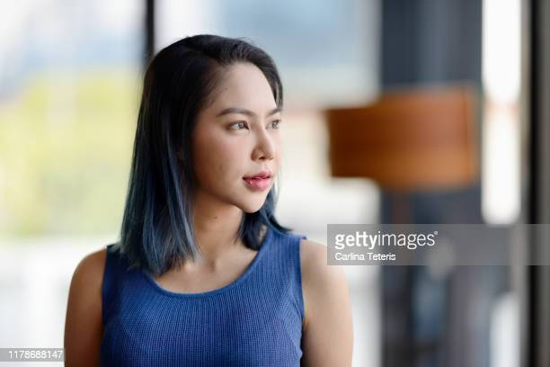 portrait of a thai business woman with blue hair - sleeveless top stock pictures, royalty-free photos & images