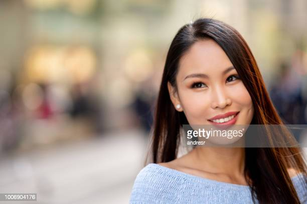 portrait of a thoughtful asian woman - mongolian models stock pictures, royalty-free photos & images