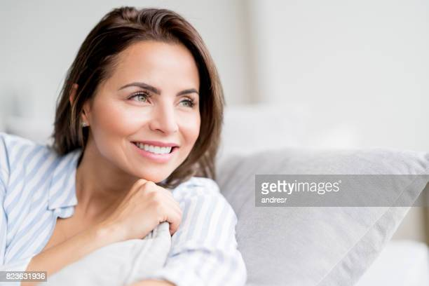Portrait of a thoughtful woman relaxing at home