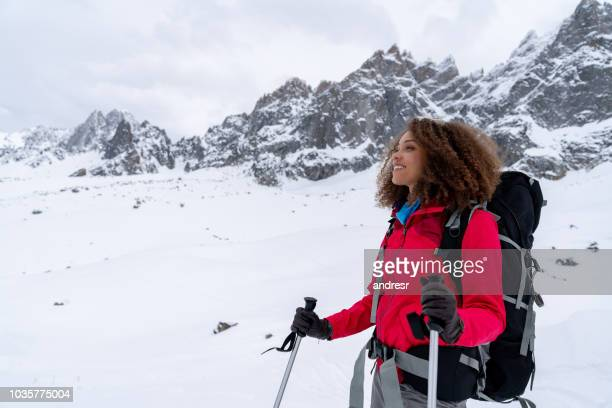 portrait of a thoughtful woman trekking in the snow mountains - winter sport stock pictures, royalty-free photos & images