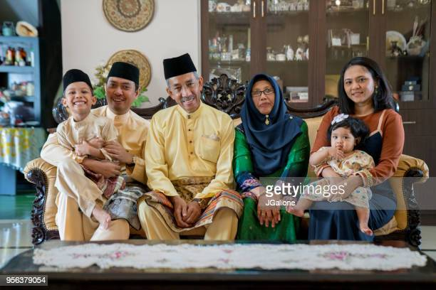 portrait of a three generation family - malaysian culture stock pictures, royalty-free photos & images