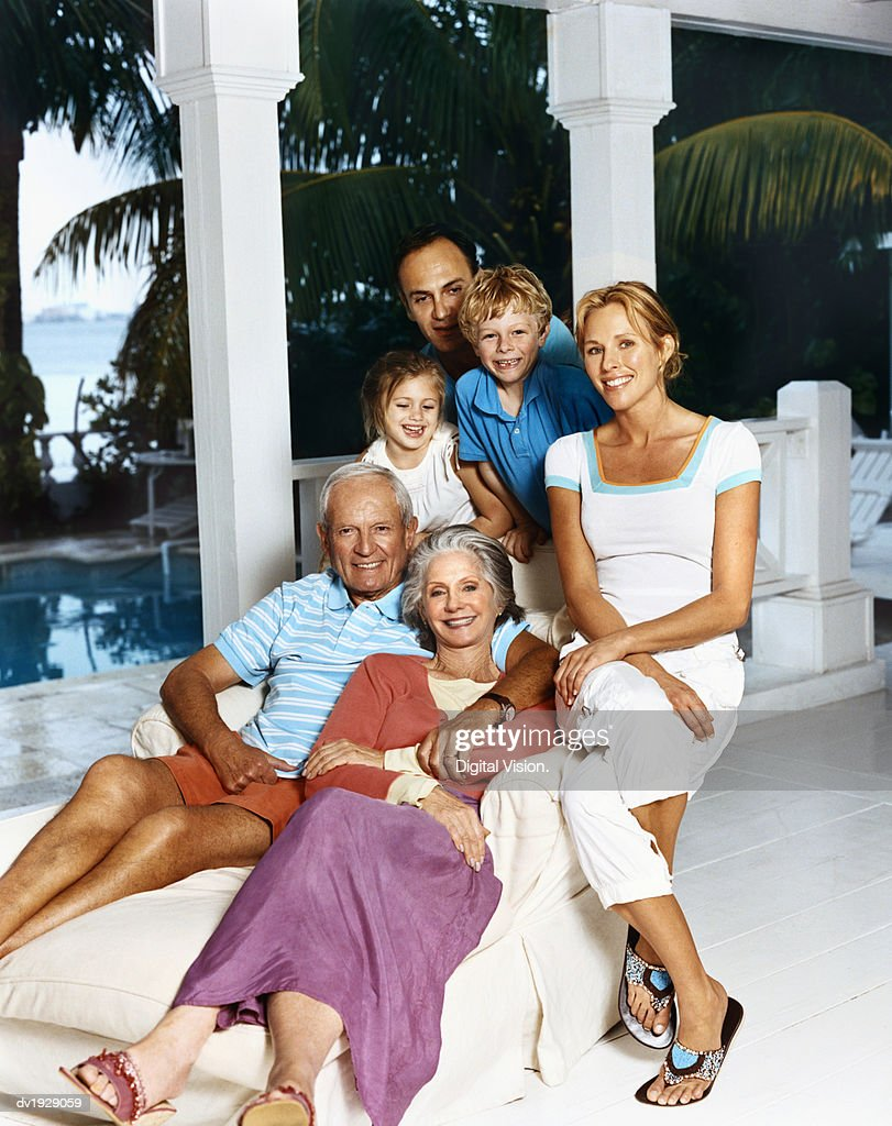 Portrait of a Three Generational Family Sitting on the Porch of Their Holiday Home : Stock Photo
