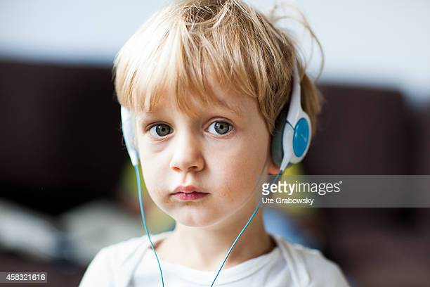 Portrait of a threeyearold boy wearing headphones on August 05 in Sankt Augustin Germany Photo by Ute Grabowsky/Photothek via Getty Images