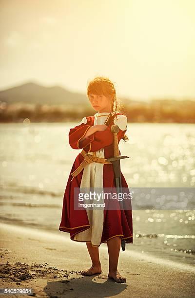 Portrait of a  tough little viking shieldmaiden