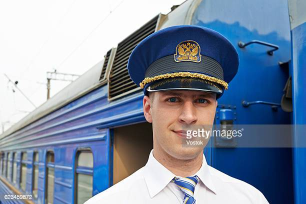 Portrait of a train conductor