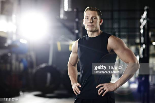 portrait of a trainer in gym - sportswear stock pictures, royalty-free photos & images