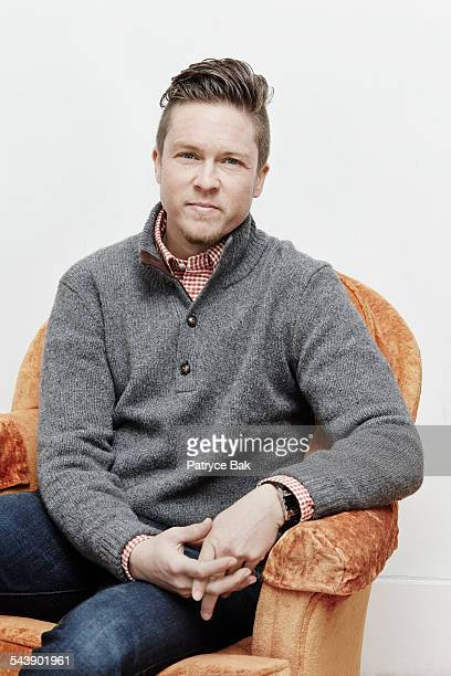 portrait of a transgender man in living room - ftm stock photos and pictures