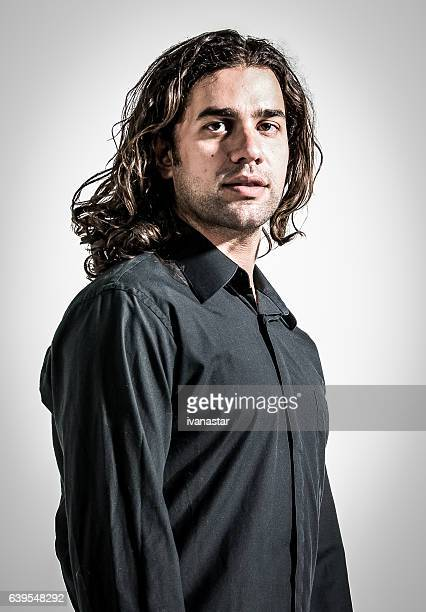 portrait of a trendy hipster young man - long hair stock pictures, royalty-free photos & images