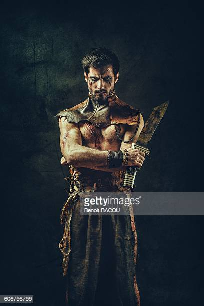Portrait of a tribal warrior standing arms crossed