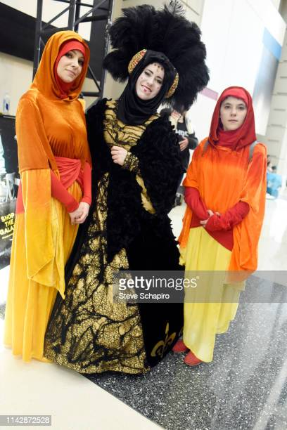 Portrait of a trio of attendees, one dressed as 'Padme Amidala' and two as handmaidens, at the Star Wars Celebration event at Wintrust Arena,...