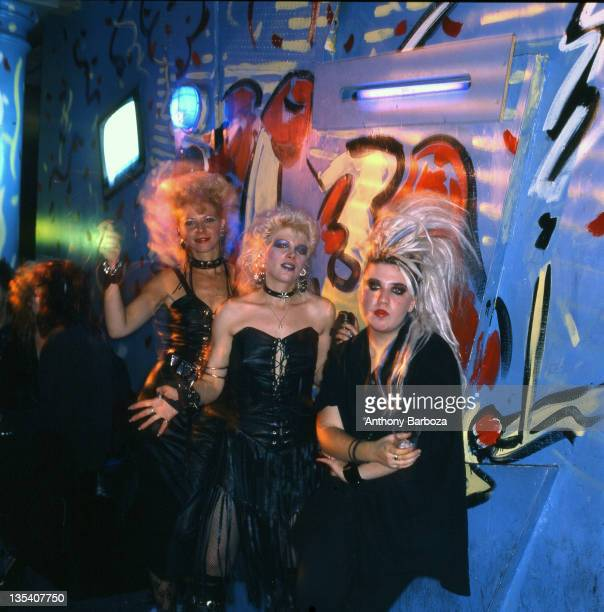 Portrait of a trio of flamboyantly dressed female punk rock fans at an unidentifed nightclub New York New York 1980s