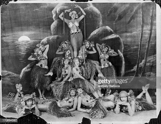 Portrait of a troupe of showgirls as they pose in costume on stage Harlem New York New York early twentieth century