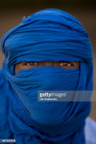 Portrait of a Tuareg Man wearing a blue turban on December 07 in Niamey Niger The Tuareg are a Berber people with a traditionally nomadic pastoralist...