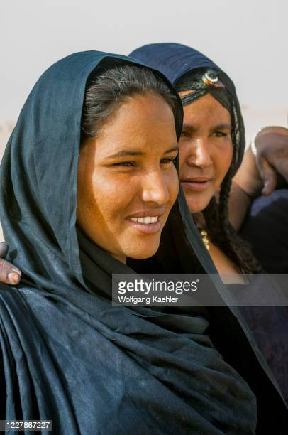 Portrait of a Tuareg woman during a traditional dance performance in the desert at the edge of Timbuktu, Mali, a city on the edge of the Sahara.