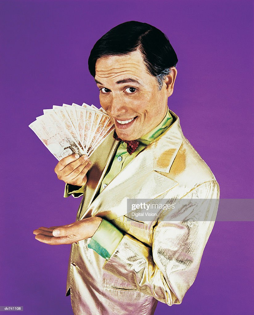 Portrait of a TV Presenter Holding Money : Stock Photo