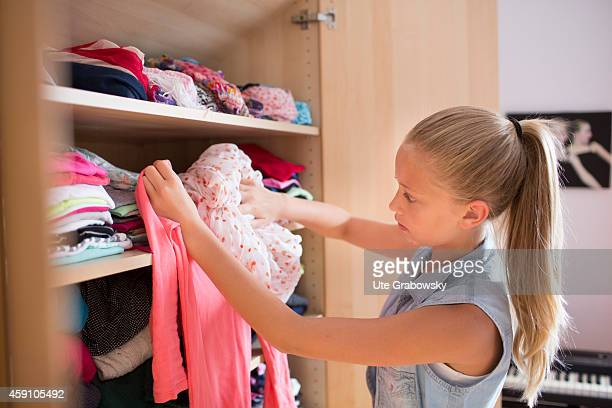 Portrait of a twelveyearold girl choosing an outfit on August 12 in Duelmen Germany Photo by Ute Grabowsky/Photothek via Getty Images