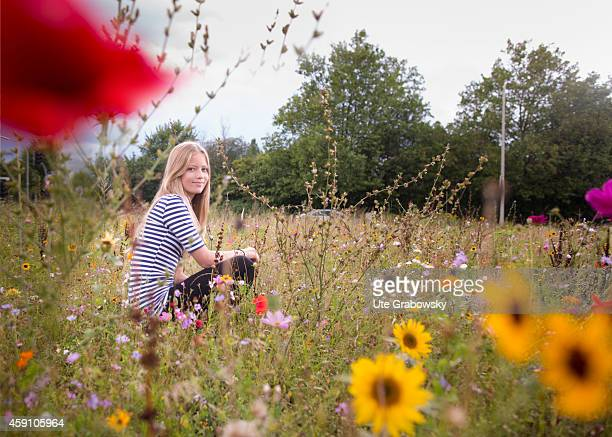 Portrait of a twelveyearold girl on a flower meadow on August 12 in Duelmen Germany Photo by Ute Grabowsky/Photothek via Getty Images