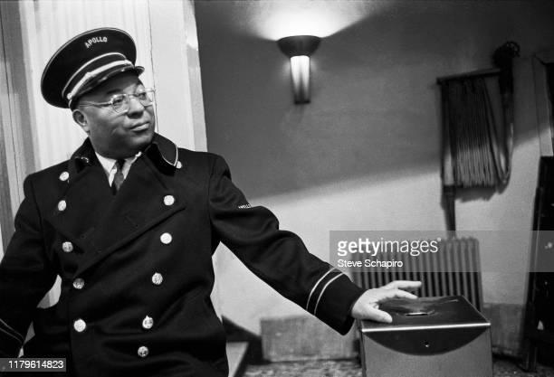 Portrait of a uniformed usher at the Apollo Theater, New York, New York, 1961.