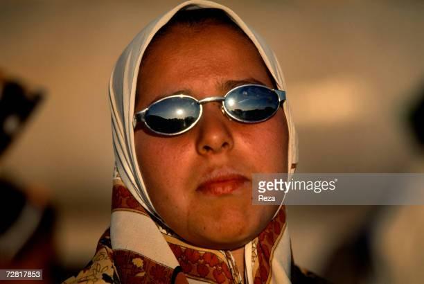 A portrait of a veiled schoolgirl during a picnic by Ein Dabban lake April 2000 in Ein Dabban Lake Libya