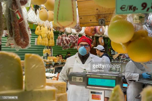 Portrait of a vendor in the Porta Palazzo food market in Turin Italy on March 17 2020 The food section is the only that is open during of the Italy...