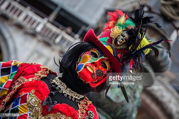 Portrait of a Venetian Carnival colored mask, in St. Mark's Square, venice, italy