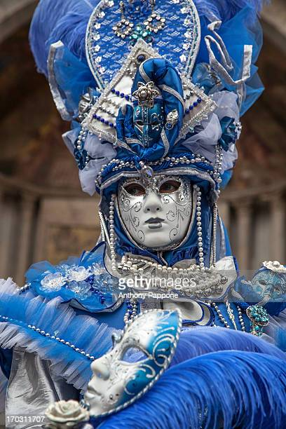 CONTENT] portrait of a Venetian Carnival mask in St Mark's Square venice italy