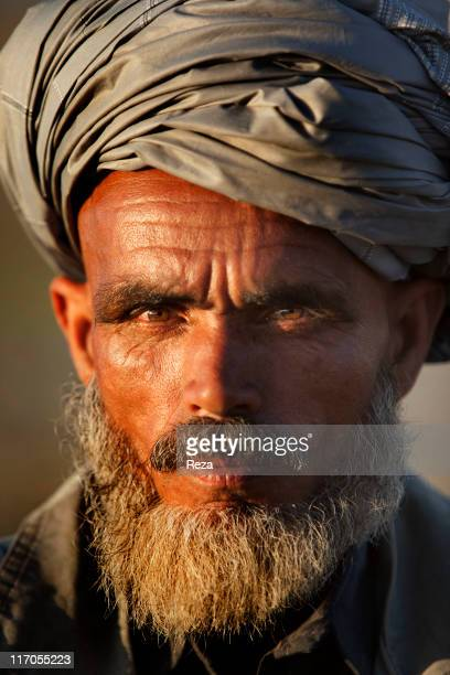 Portrait of a villager standing on the Kokchah River's bank May 17 2009 in Takhar Province Afghanistan
