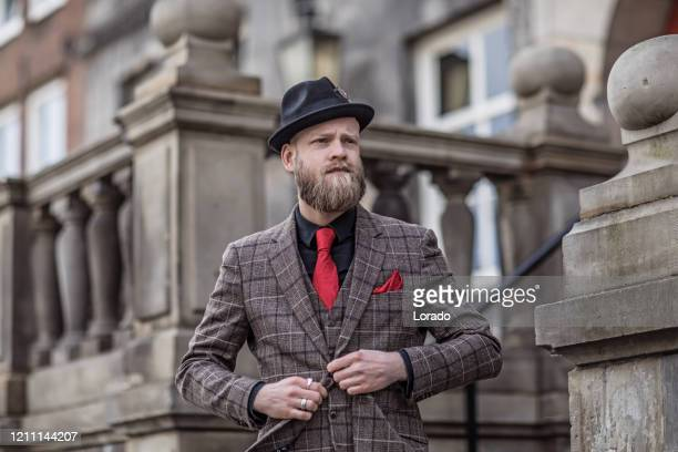 portrait of a vintage gangster man in an old city - history stock pictures, royalty-free photos & images