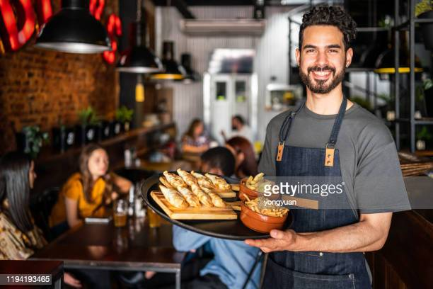 portrait of a waiter in a cafe in buenos aires - empanada stock pictures, royalty-free photos & images