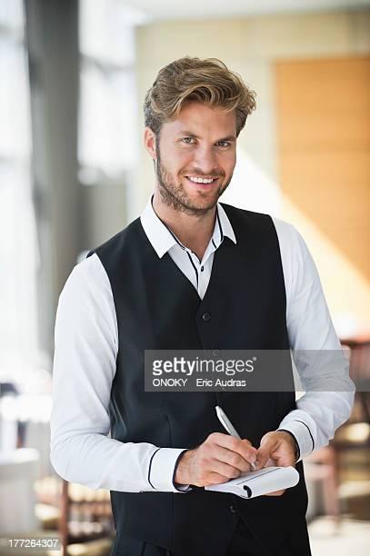 portrait of a waiter taking order in a restaurant - onoky stock-fotos und bilder