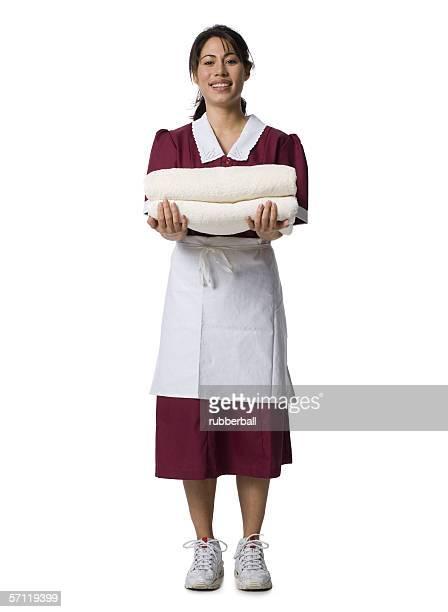 Portrait of a waitress holding towels