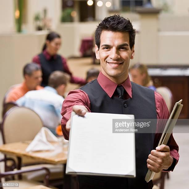 Portrait of a waitress with a menu