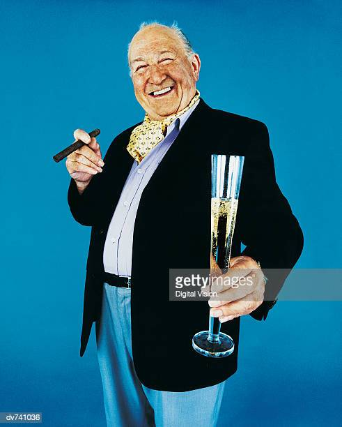 Portrait of a Wealthy Man Holding a Tall Glass of Champagne