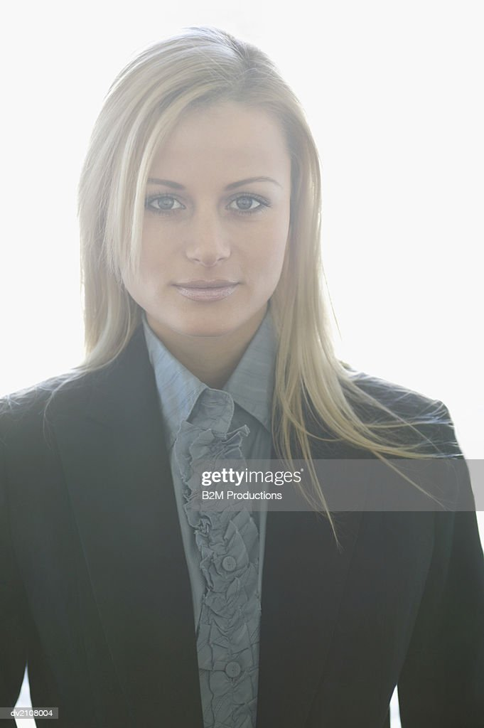 Portrait of a Well Dressed Woman Wearing a Ruffled Shirt : Stock Photo