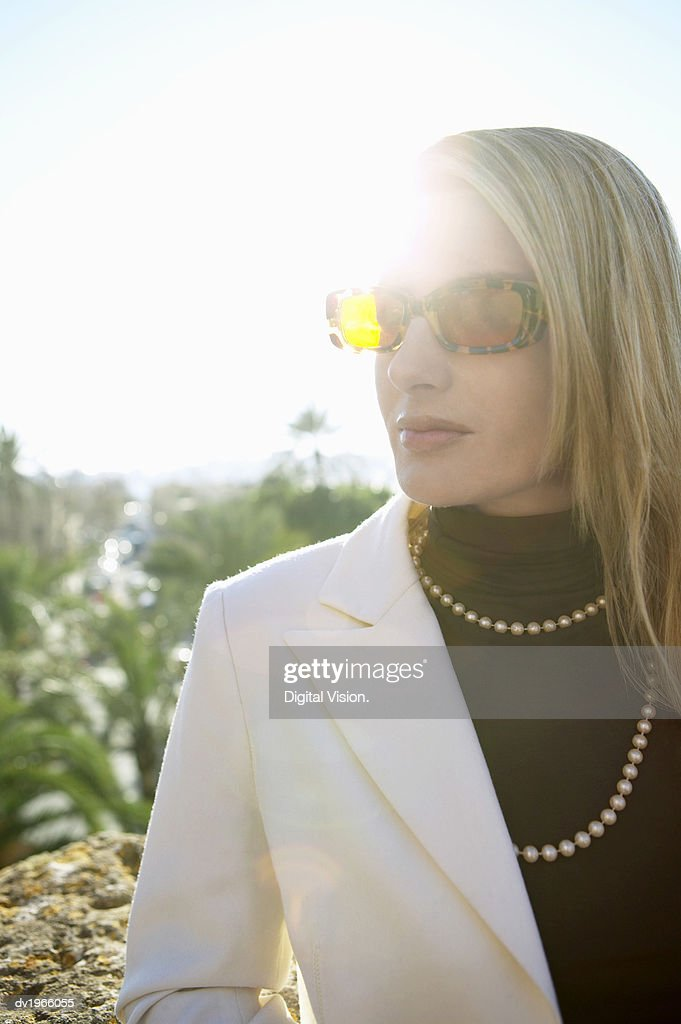 Portrait of a Well Dressed Woman Wearing Sunglasses : Stock Photo