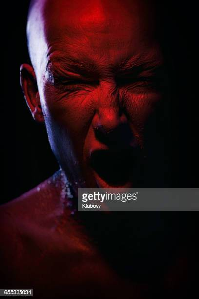 portrait of a white/red human - body paint photos stock photos and pictures