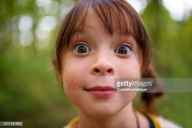 portrait of a wide-eyed girl standing outdoors, united states - 4歳から5歳 ストックフォトと画像