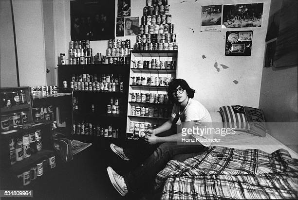 Portrait of a Wilde Lake High School freshman as he sits on his bed, surrounded by his beer can collection, Columbia, Maryland, 1977.